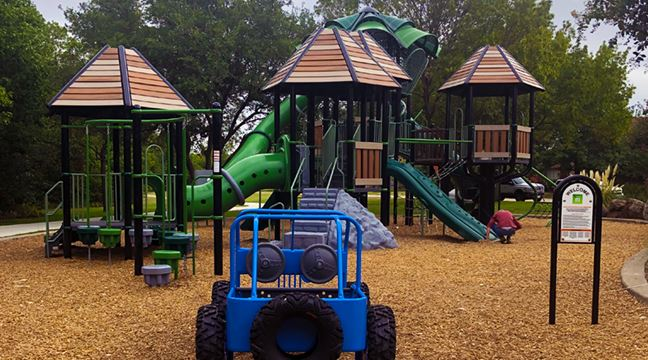 playground with tube slides and kid-sized Jeep