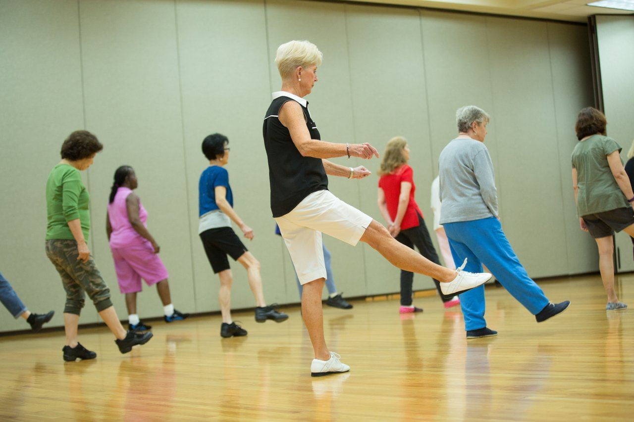 Senior adults participate in line dancing class