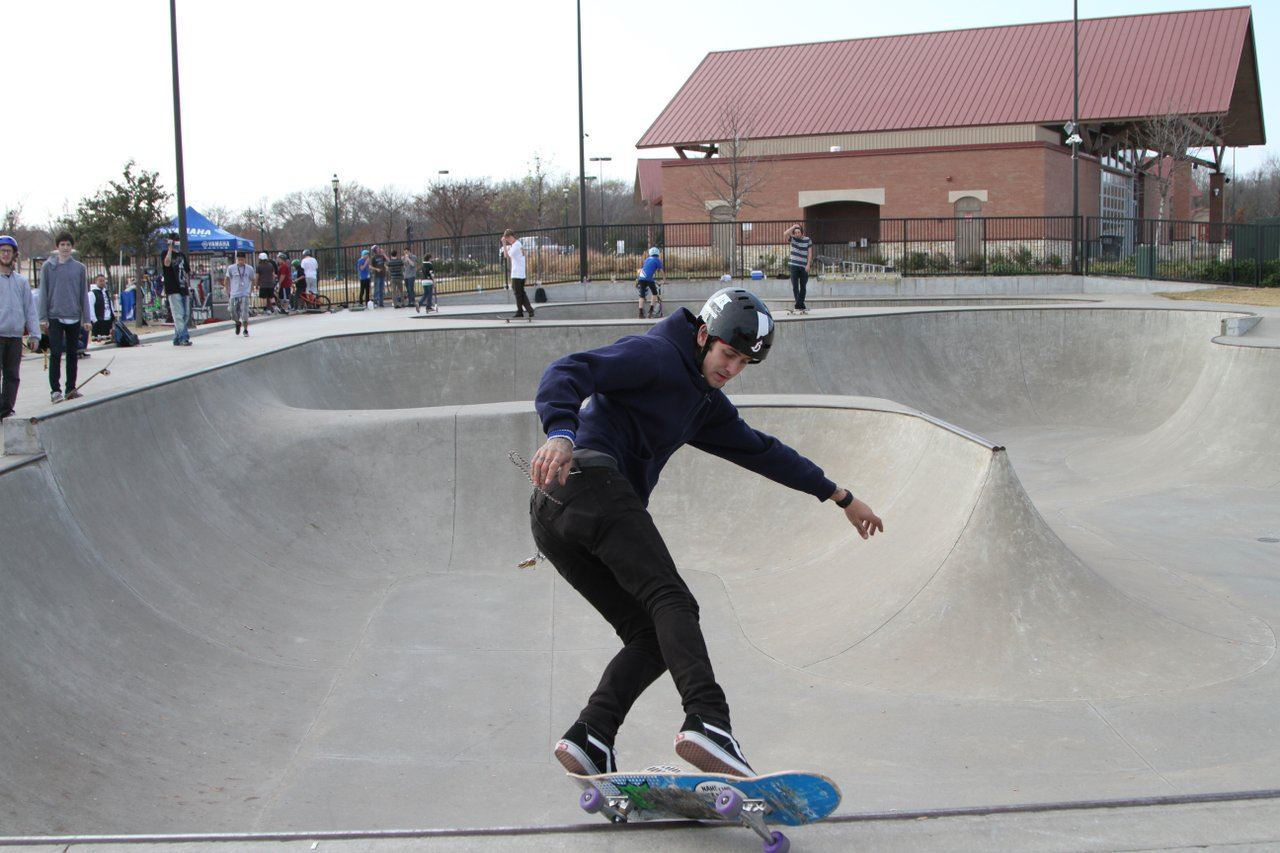 skateboarder doing tricks at The Edge Skate Park