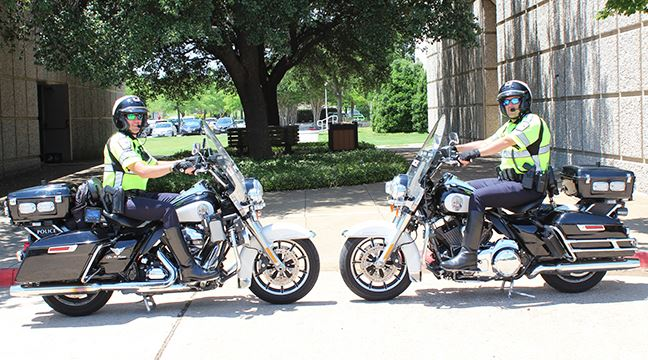 Two Allen police officers sitting on motorcycles