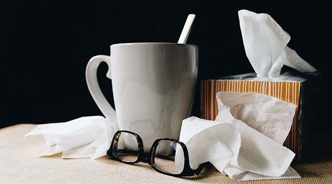 Tissues and a hot drink sitting a table