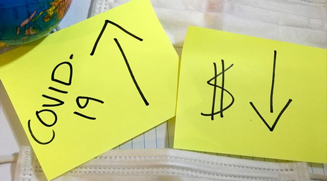 Two post-it notes. One says COVID-19, the other has a money symbol and arrow pointing down