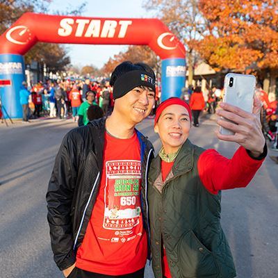 Man and woman taking selfie at a race starting line