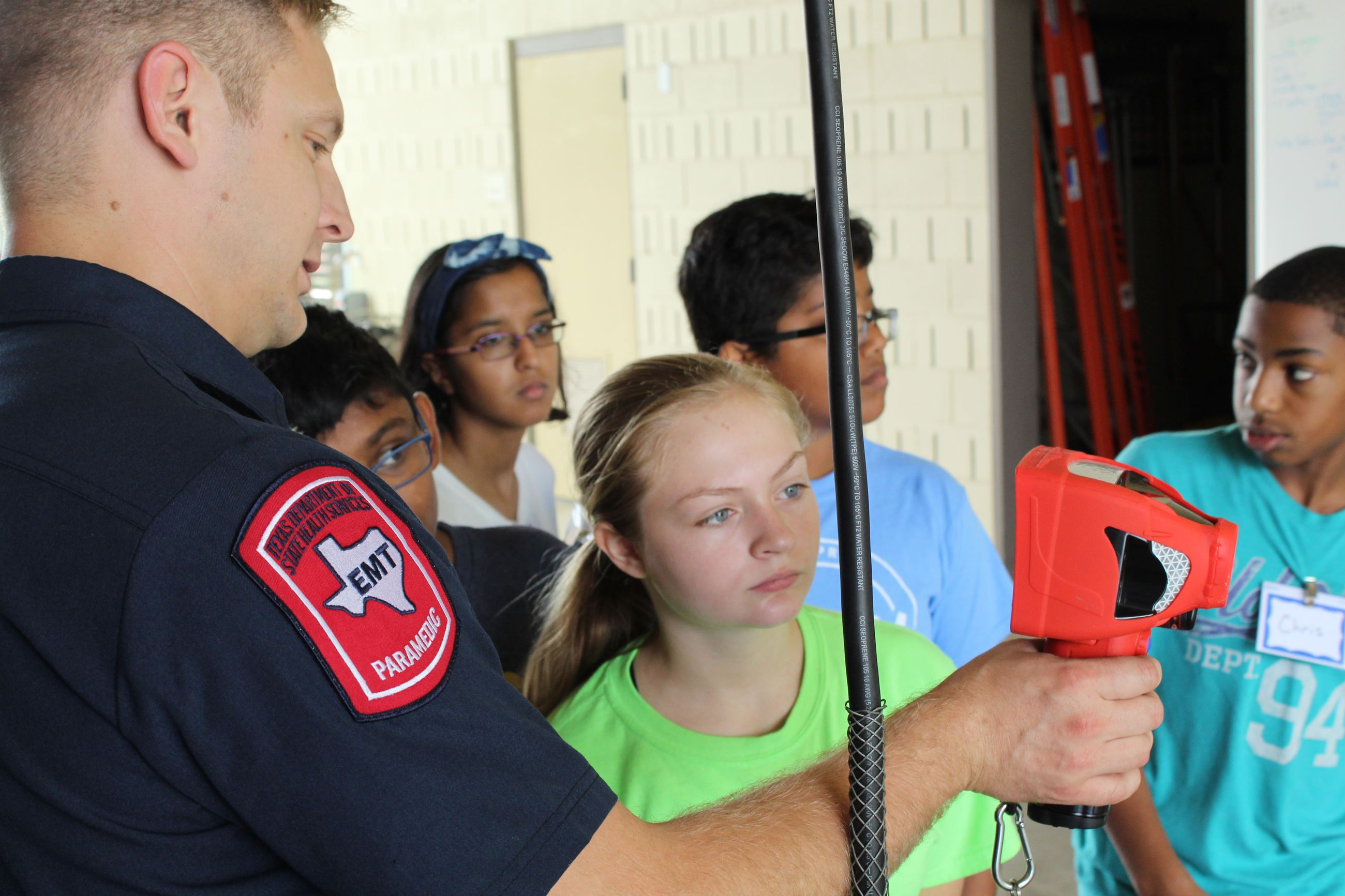 Allen firefighter gives equipment demonstration for onlooking students