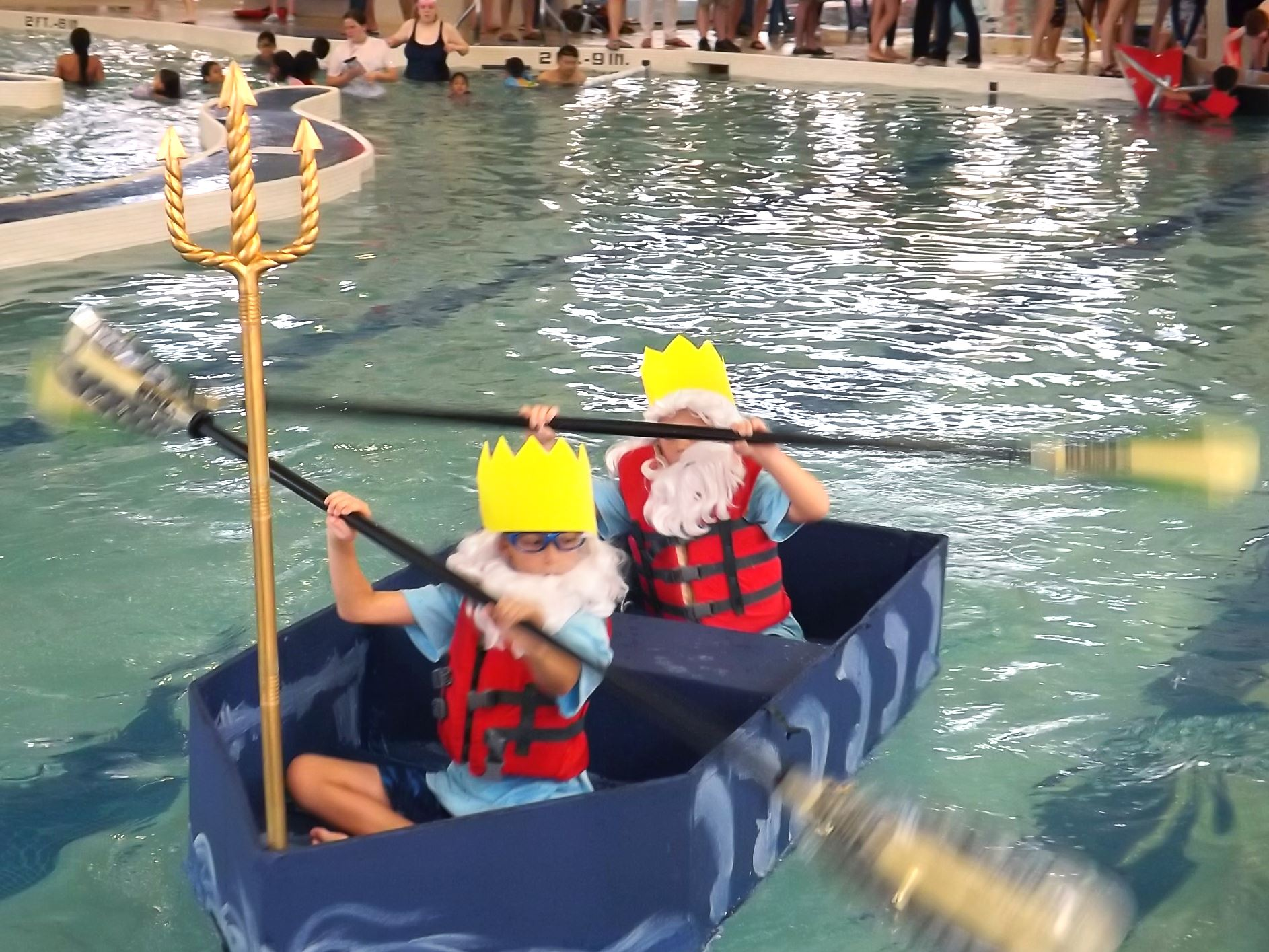 Kids participating in cardboard boat race
