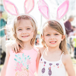 Two young girls wearing bunny ears