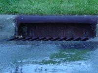 water flowing down storm drain