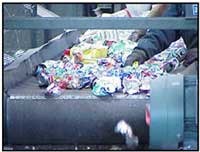 recyclable materials traveling down a large conveyor belt