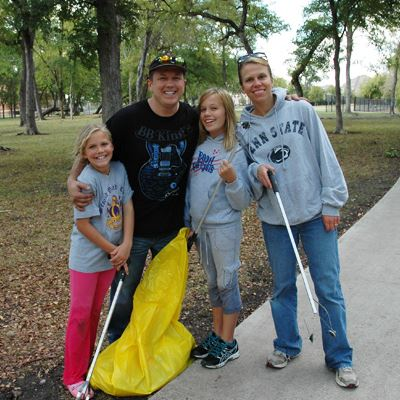 Family collecting litter along a trail