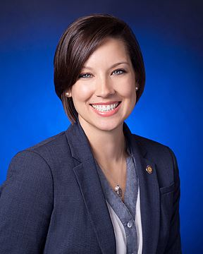 Professional photo of Rebecca Vice with blue background