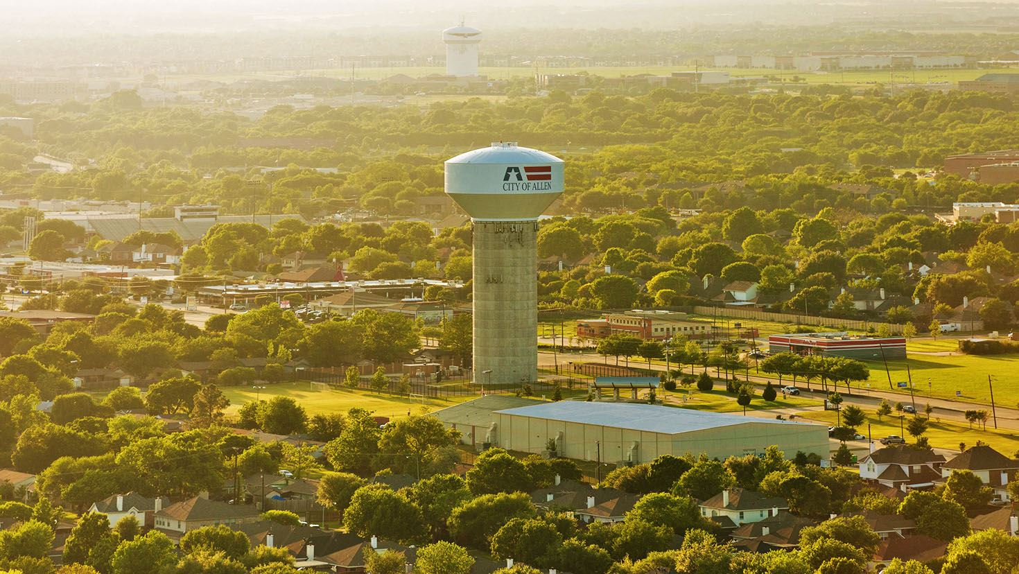Aerial photo of Allen water tower with sun shining above