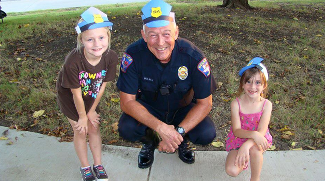 allen police officer with two kids in homemade police hats