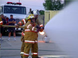 Academy student with hose