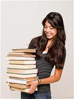 Teen girl holding books
