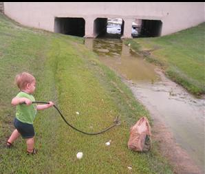 Child Participates in Adopt a Waterway